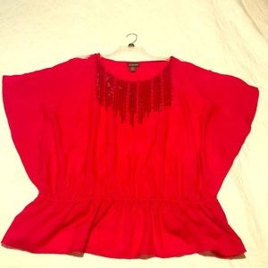 Beautiful red blouse with sequins. Size 18/20.